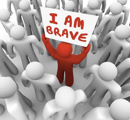 Ik ben dapper woorden op een bord gehouden door een man in een menigte toont hij is uniek en anders in het zijn vet, durf, moed en vertrouwen Stockfoto