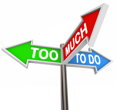 prioritize: Too Much to Do words on three road or street arrow signs pointing or directing you to many jobs or tasks to be done