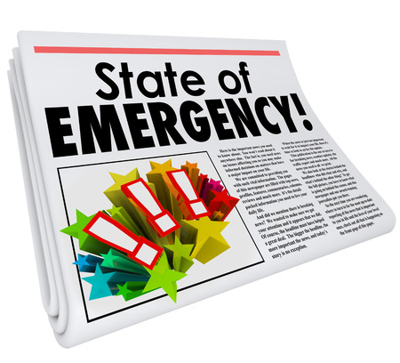 State of Emergency words in newspaper headline for a story about a big crisis, trouble, problem or urgent catastrophe photo