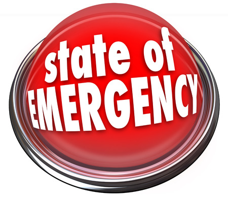 catastrophic: State of Emergency words on a 3d flashing light or button warning about a crisis, trouble, catastrophe or disaster
