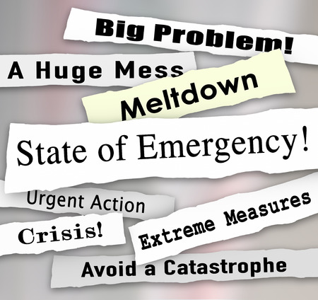 catastrophic: State of Emerency words in a ripped newspaper headline, with big probelm, huge mess, meltdown, urgent action and crisis Stock Photo
