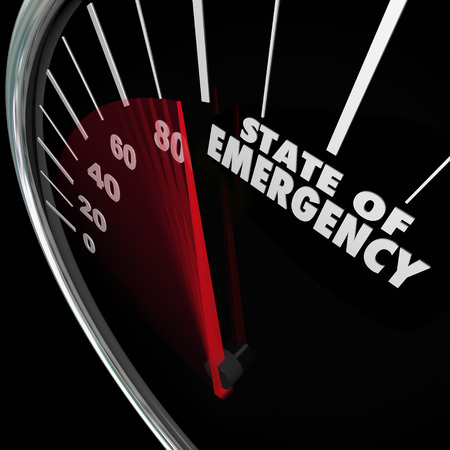 approaching: State of Emergency words on a speedometer measuring a fast approaching crisis, problem, trouble or issue Stock Photo