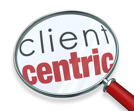 centering: Client Centric words under a red magnifying glass illustrating a business model focused on the needs of serving customers first