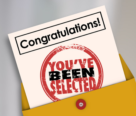 Congratulations Youve Been Selected words on an official letter or notification in an envelope to a winning candidate or lucky person Stock Photo