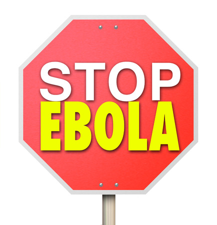 critical conditions: Stop Ebola words on a red road sign to stop or cure the deadly disease or virus from spreading Stock Photo