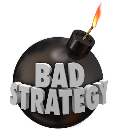 failing: Bad Strategy words in 3d letters on a round bomb about to explode causing a terrible disaster or catastrophe because of your misguided plan or unsuccessful idea