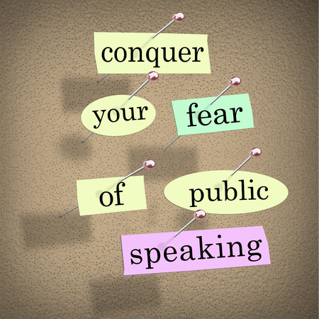 overcome: Conquer your fear of public speaking words on papers pinned to a bulletin board, advice to overcome stage fright when giving a major speech at an event or meeting