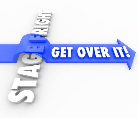 public speaking: Get Over It words on a blue 3d arrow jumping over the words Stage Fright to illustrate conquering or overcoming a fear of public speaking