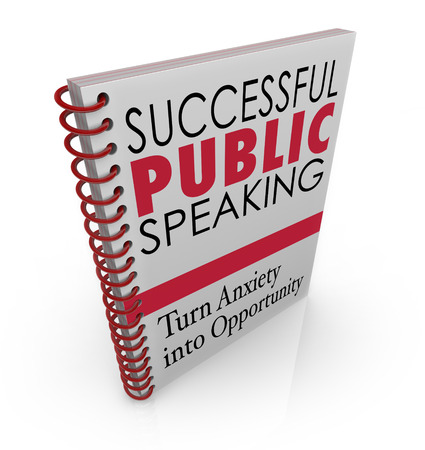 Successful Public Speaking words on a book cover for advice, help, tips and assistance in delivering a big speech at an event, meeting or conference photo