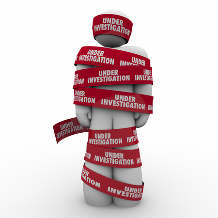 under arrest: Under Investigation words on red tape wrapped around a man or person suspected of a crime and detained for questioning