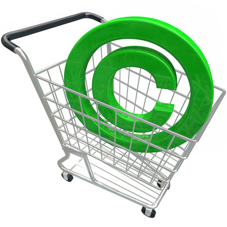 A green 3d copyright symbol in a shopping cart illustrating the purchase or buying legally protected intellectual property photo