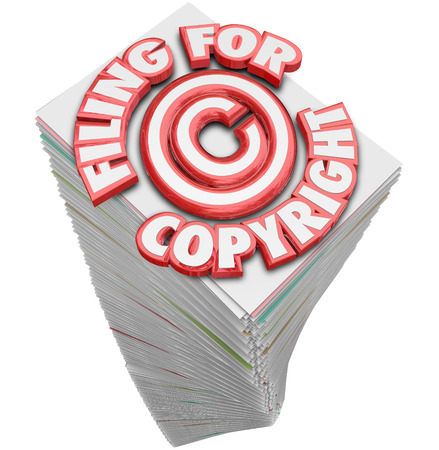 Filing for Copyright 3d words on a stack of papers and documents you must fill out to safeguard your intellectual property from thieves and piracy photo