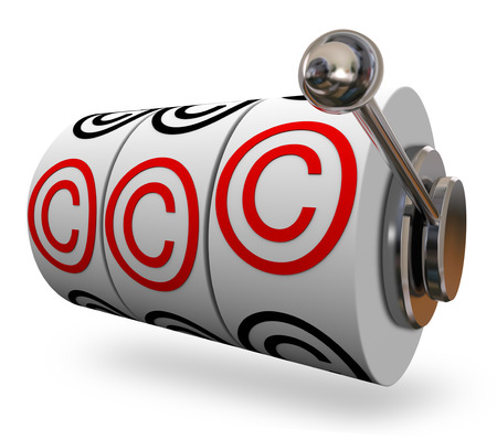 protecting your business: Copyright symbols or letter C on three slot machine wheels illustrating you won legal protection for your intellectual property Stock Photo