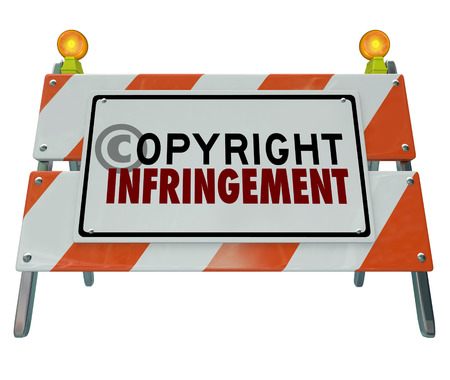 Copyright Infringement words on a road construction barricade sign illustrating a violation of intellectual property or piracy