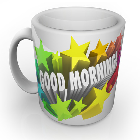 Good Morning words surrounded by stars on a coffee mug as a fresh start to a new day
