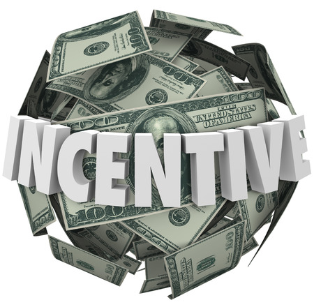 Incentive word in 3d white letters around a ball or sphere of hundred dollar bills to illustrate financial encouragement to buy or sell