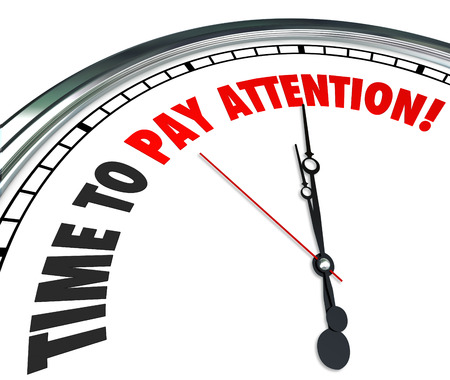 pay: Time to Pay Attention words on a 3d clock face to illustrate importance of listening and hearing vital or urgent information