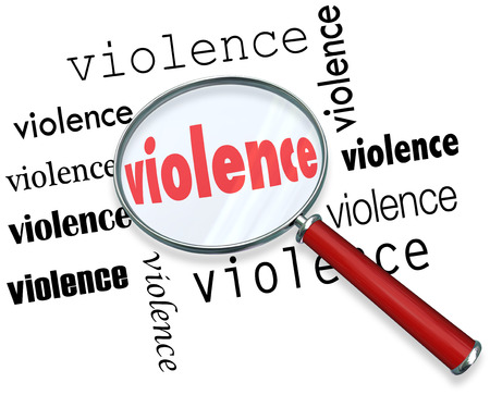Violence word under magnifying glass to illustrate research or investigation into causes of violent acts Stock Photo