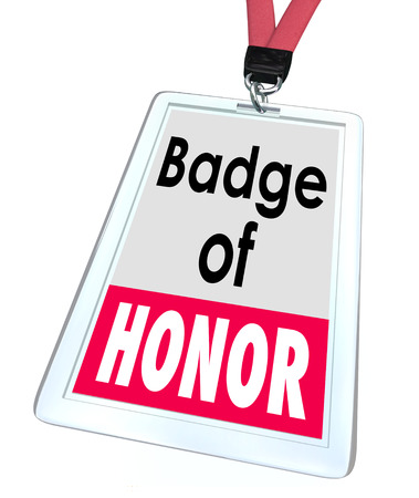Badge of Honor words on an employee name or identification badge as worker pride in his or her organization photo