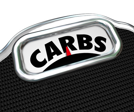 carbohydrates: Carbs word on a scale to illustrate eating too much carbohydrates in your diet and needing to cut on snack food and lose weight