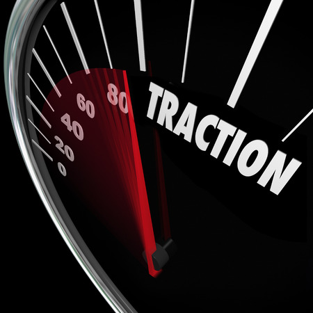 traction: Traction word on 3d speedometer measuring the amount of ground you have gained or momentum as you build popularity or acceptance Stock Photo