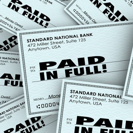 budgetary: Paid in Full words on checks in a pile to illustrate money owed and being recouped with interest Stock Photo