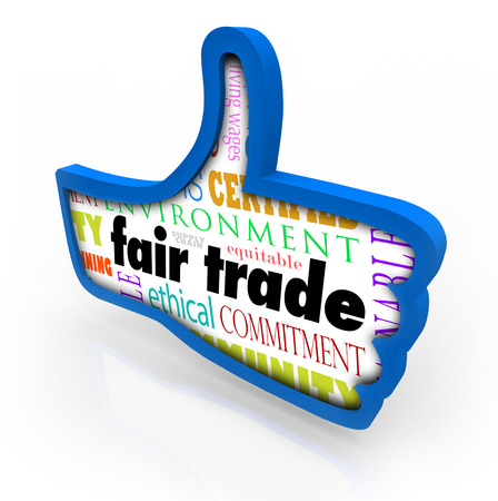 Fair Trade words in a blue thumbs up symbol to illustrate customers approving, liking or reviewing a company with responsible business practices photo