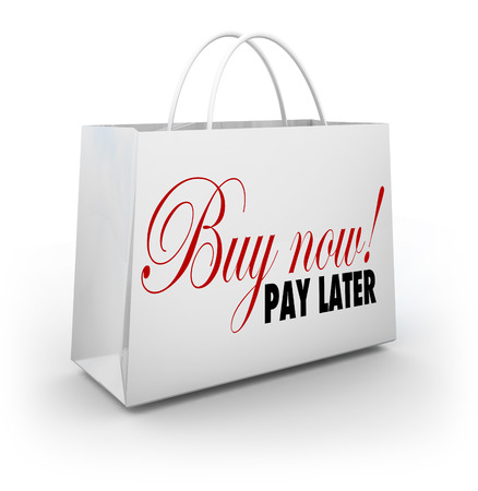 borrowing: Buy Now Pay Later words on a shopping bag to advertise a special deal on financing your purchase during a sale or store event