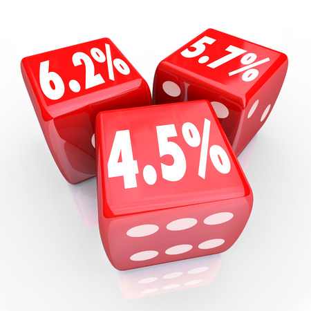 mortgaging: Interest rate numbers and percentages on three red dice to advertise special low rates on financing debt or credit cards