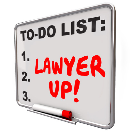 reminding: Lawyer Up words written with red marker or pen on a to-do list dry erase board reminding you to hire an attorney to handle a legal problem or lawsuit Stock Photo