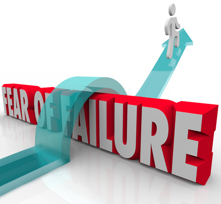 Fear of Failure words in red 3d letters and a man jumping over it to overcome a challenge such as anxiety or uncertainty