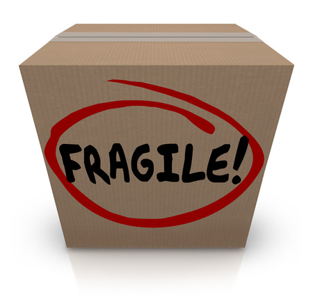 flimsy: Fragile word written on a cardboard box full of delicate or breakable items to move or ship in the mail Stock Photo
