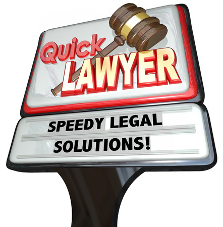 defendant: Quick Lawyer sign advertising a law firm of attorneys promising speedy legal solutions to your problems or lawsuits Stock Photo