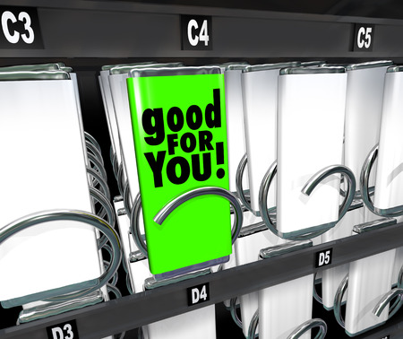 vending: Good for You words on a snack or food wrapper or package in a vending machine to illustrate shopping for and comparing options and choices Stock Photo