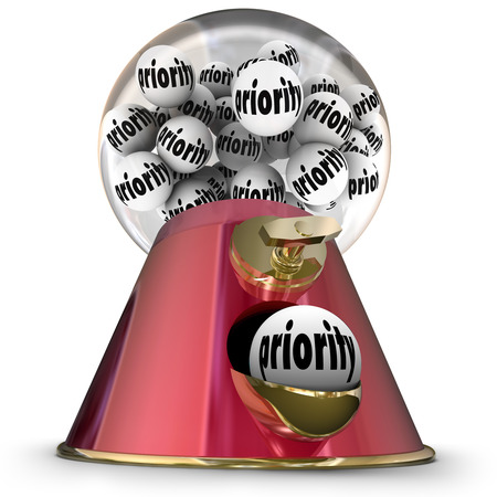 prioritizing: Priority word on gum balls in a machine or dispenser to choose or select the most important item or customer waiting for service