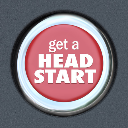 head start: Get a Head Start words on a round red car ignition button to illustrate an early edge or competitive advantage in a career, job, education, school or life