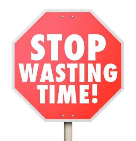 Stop Wasting Time words on a red road warning sign to help you better manage your hours and minutes for more efficiency and productivity