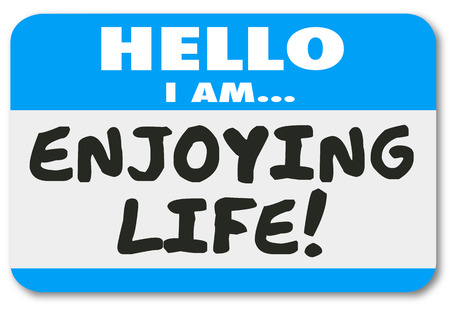nametag: Hello I Am Enjoying Life words on a nametag sticker introducing you as someone relaxing or taking pleasure in time off like holiday, vacation or retirement