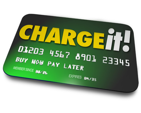 borrowing: Charge It words on a green credit card to illustrate shopping and buying now and paying later as a loan you are obligated to pay Stock Photo