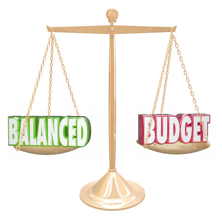 Balanced Budget 3d words on a gold scale weighing costs against revenues in accounting or bookkeeping Archivio Fotografico