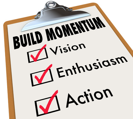 momentum: How to Build Momentum words on a checklist on clipboard offering advice for moving forward and progress