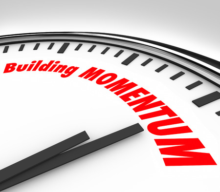 momentum: Building Momentum words on a clock measuring time and movement forward for progress