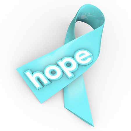 finding a cure: Hope word on a blue ribbon to raise awareness and increase funding for finding a cure to a disease like cancer Stock Photo