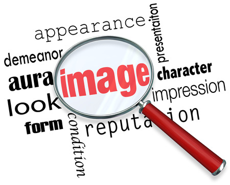impression: Image words under a magnifying glass to illustrate appearance, impression and demeanor