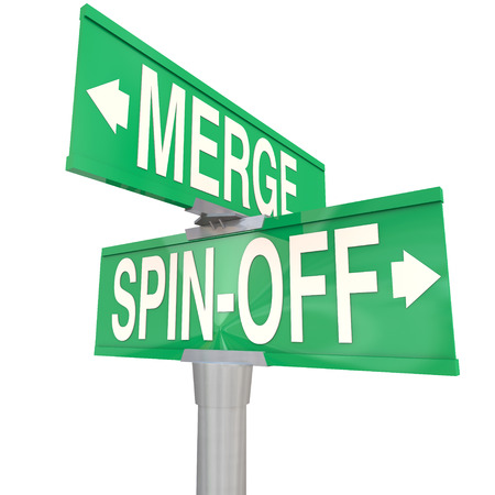 Merge Vs Spin-Off words on a two-way road intersection sign directing you to choose between combining or splitting companies or businesses photo