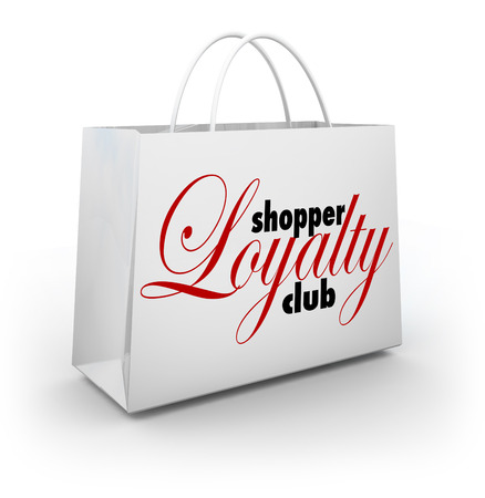 frequent: Shopper Loyalty Club words on a store shopping bag as a promotional rewards program for customers and consumers