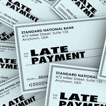 collectors: Late Payment words on checks in a pile as overdue bills being paid to banks, credit cards or other obligations Stock Photo