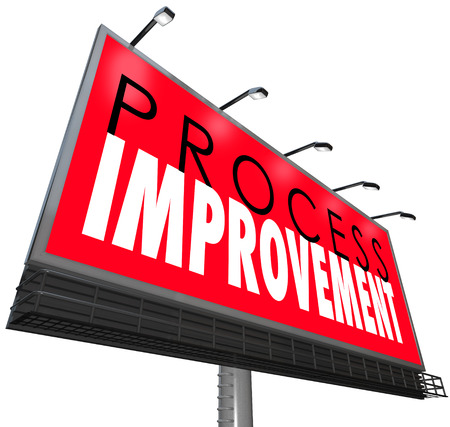 overhaul: Process Improvement words on a billboard or sign ot illustrate an overhaul of outdated processes, systems, steps or organization