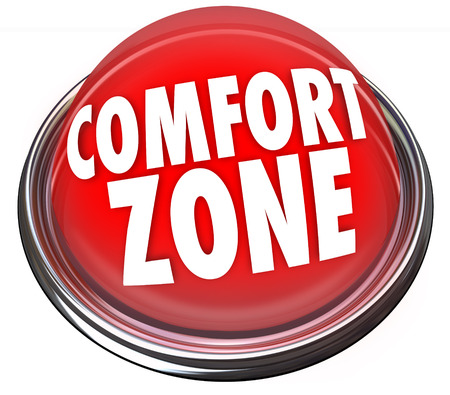 immobile: Comfort Zone words on a red light or button to illustrate a safe or secure place and fear of trying new things