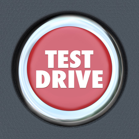 Test Drive words on a round red car start or ignition button for an evaluation or testing driving of a vehicle you are thinking of buying Stock Photo